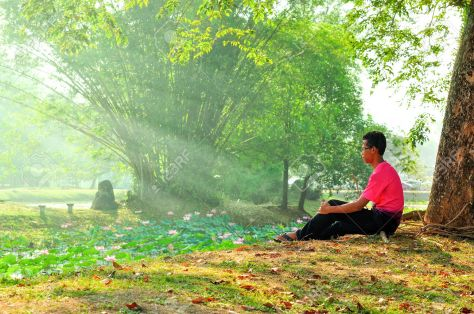 Man sitting alone under tree